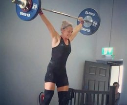 Kate overcomes back injury to become weightlifting champion