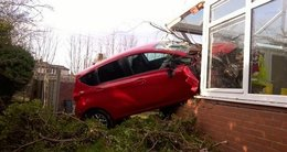 OAP had a lucky escape after his car ploughed into a house